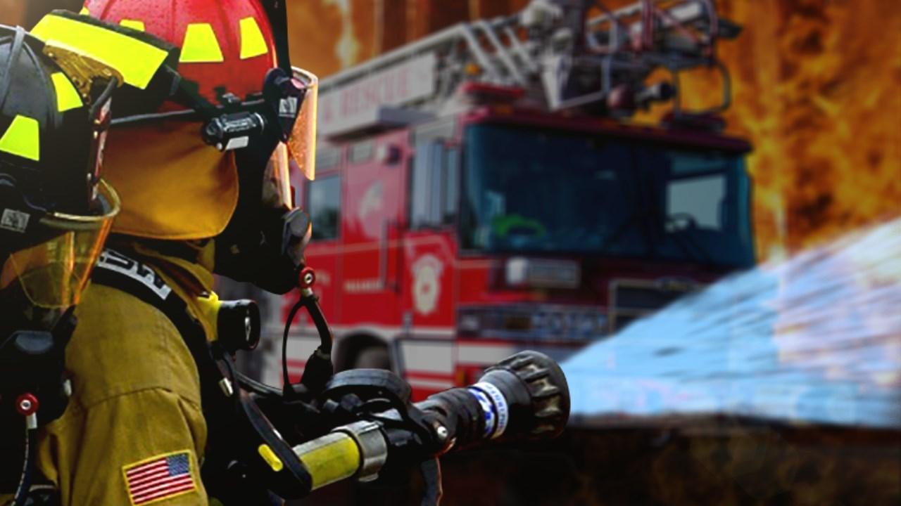 firefighter and truck_1555879703651.jpg.jpg
