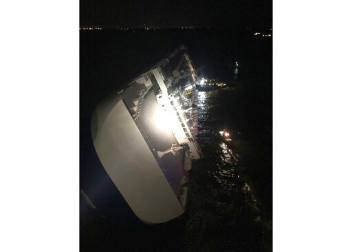The Latest: 4 missing after cargo ship overturns off Georgia